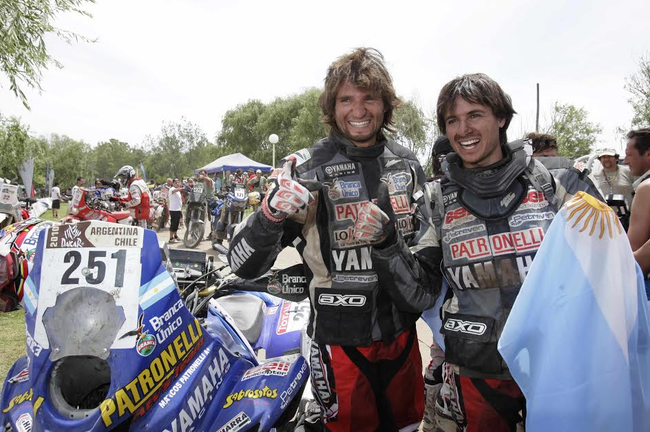 Argentinian brothers Marcos, left, and Alejandro Patronelli, celebrate after ending first and second in the quad category at the Argentina-Chile Dakar Rally 2010 in Bolivar, Argentina, Saturday, Jan. 16, 2010. (AP Photo/Natacha Pisarenko)